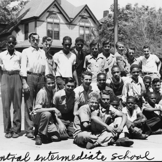 26 school boys of many different ethnicities pose for a group photo and 1939 Central Intermediate School is written on the bottom of the photo